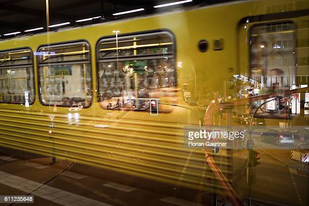 A metro is reflected on a window with the view to a crossroad on September 28 2016 in Berlin Germany