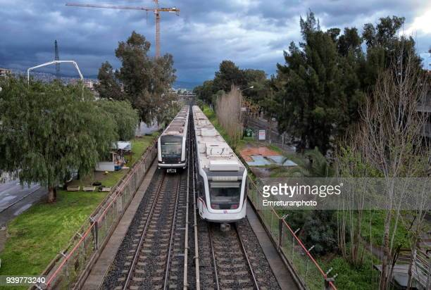 metro line with two trains crossing,izmir. - emreturanphoto stock pictures, royalty-free photos & images