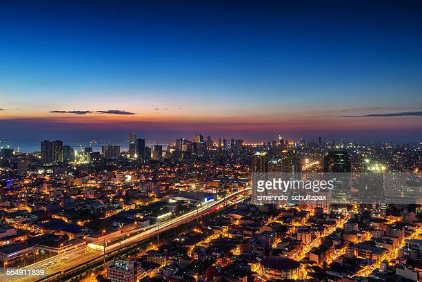 metro manila at dusk - manila philippines stock pictures, royalty-free photos & images