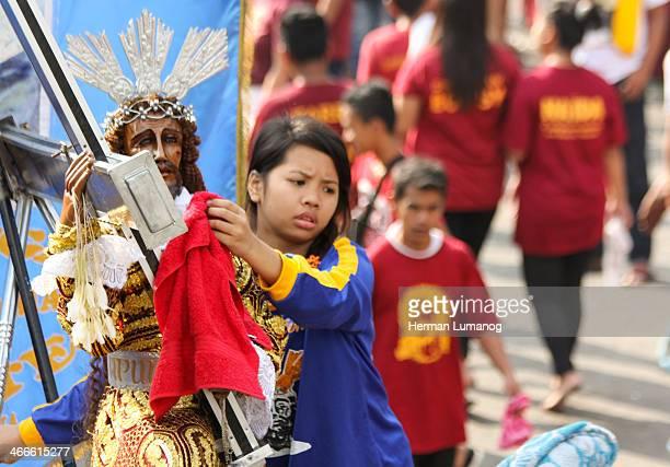 CONTENT] Metro Manila PhilippinesJanuary 9 2014 A devotee wipe a towel to the replica statue of the Black Nazarene Thousands of filipino catholic...