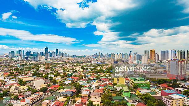 metro manila skyline during the day - makati stock photos and pictures