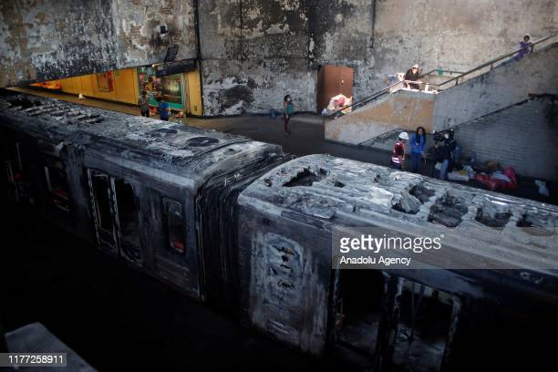 """Metro of Santiago subway at Station San Pablo """"Saint Paul"""" is seen after it was burned following demonstrations against a rise in metro fares turned..."""