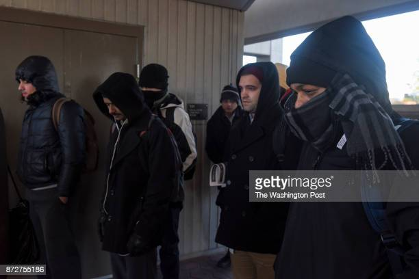 Metro riders at the WiehleReston East Station brace themselves against the cold wind as air temperatures plunge due to a polar vortex passing through...