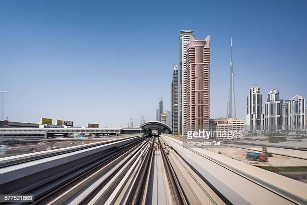 Metro Riding Through Downtown Dubai