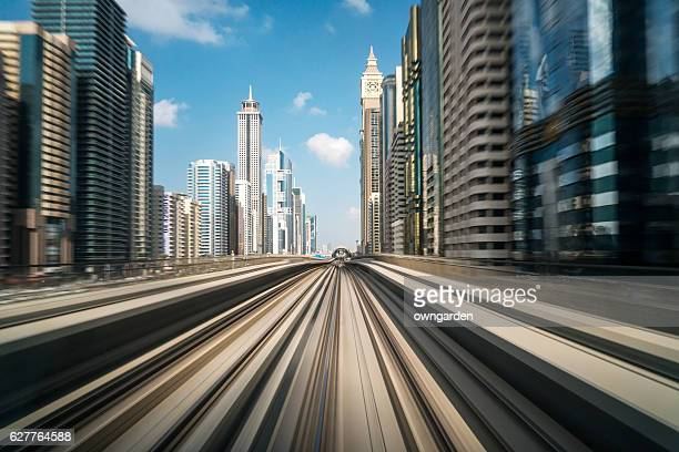Metro Riding Through Downtown Dubai