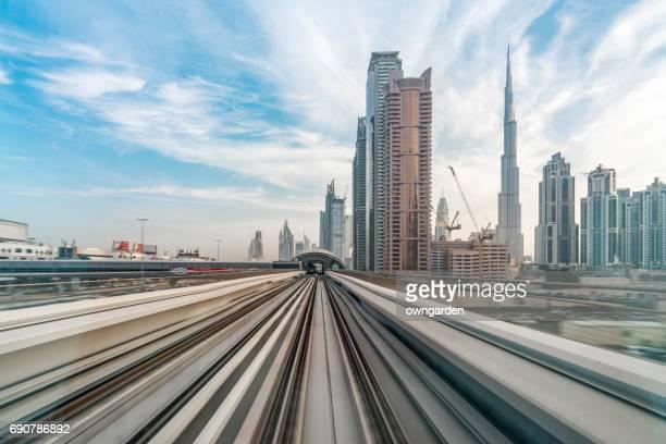 metro riding through downtown dubai - autonomous technology stock photos and pictures