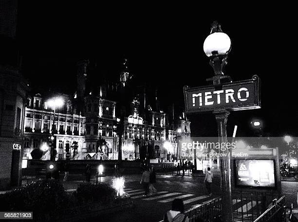 metro sign at night - paris metro sign stock pictures, royalty-free photos & images