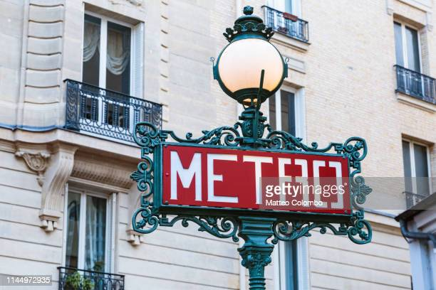 metro signpost in paris, france - paris metro sign stock pictures, royalty-free photos & images