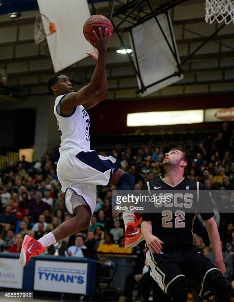 Metro State guard Jourdon Hunter shoots over University of Colorado Colorado Springs guard Alex Koehler during the first half at Metro State during...