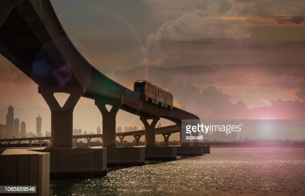 metro train at sunset. - gulf countries stock pictures, royalty-free photos & images