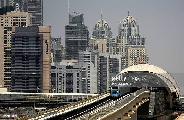 A metro train drives through Sheikh Zayed road in Dubai on September 10 2009 a day after the official opening of the Gulf emirate's metro network...