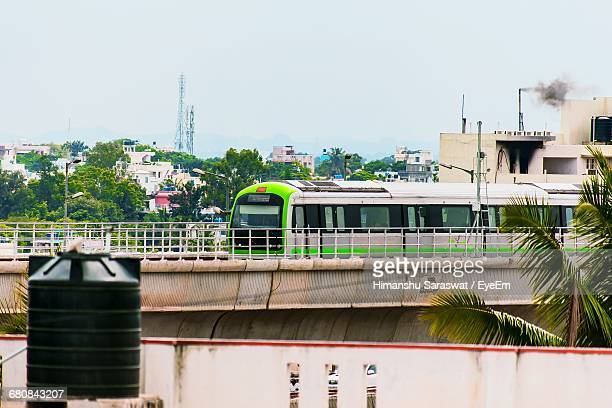 Metro Train In City Against Clear Sky