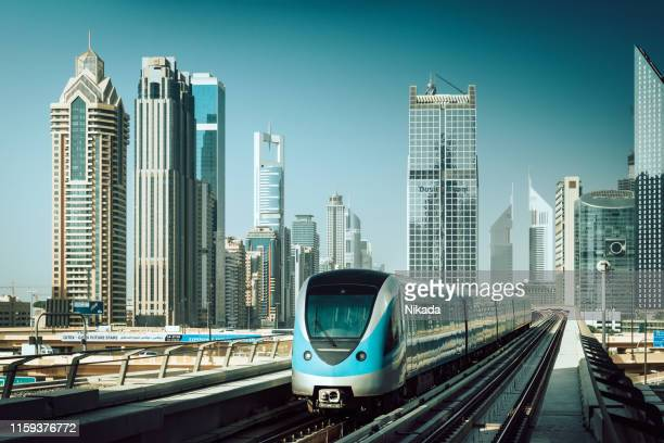metro train in dubai, uae - monorail stock pictures, royalty-free photos & images