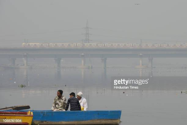 A metro train in seen through a thick layer of smog at Yamuna Nigambodh Ghat on October 29 2018 in New Delhi India The Central Pollution Control...
