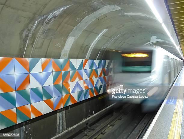 Metro train leaving a Sao Paulo subway station platform , Brazil