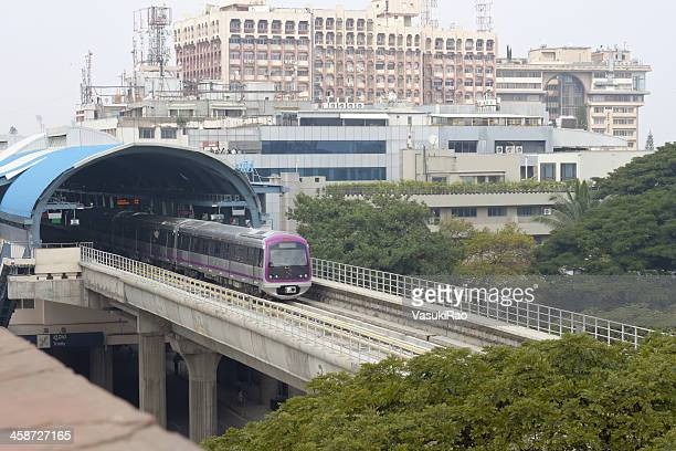 metro train moves out of station in bangalore, india - bangalore stock pictures, royalty-free photos & images