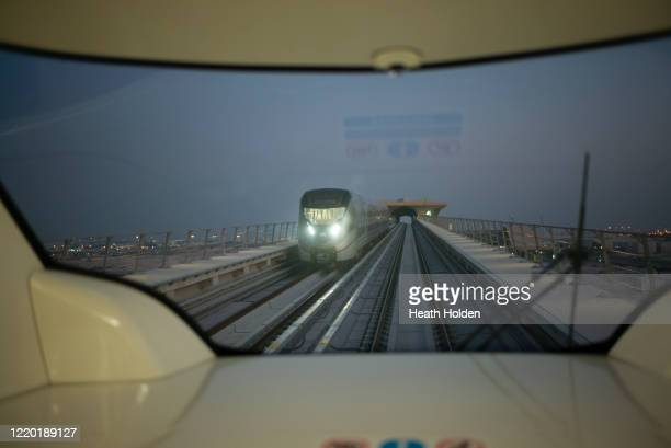 metro train on tracks. - doha stock pictures, royalty-free photos & images