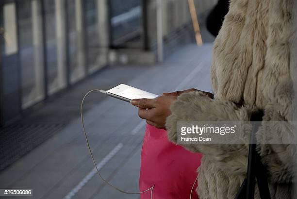 Metro train passenger using her ipad read orlisten music and studing city map 29 November 2014