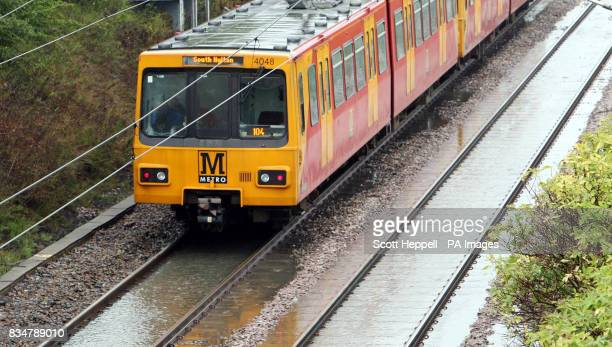 Metro train slowly travels along the flooded track's at Wardley in Gateshead, where heavy rain has put a speed restriction in place as a safety...
