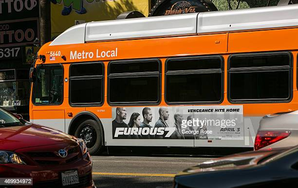Metro Transit bus displaying a 'Furious 7' promotional billboard moves along Hollywood Boulevard on March 23 2015 in Hollywood California Millions of...