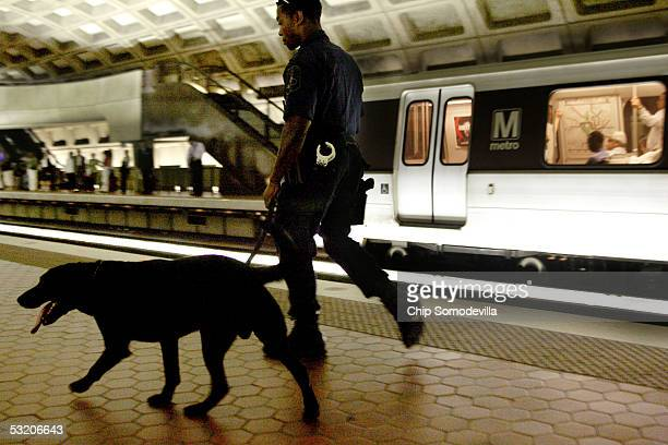 Metro Transit Police Special Response Team member Anthony Montgomery patrols the Metro Center station with Sabre an explosives detection dog July 7...
