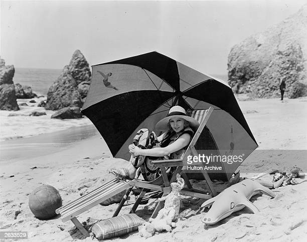 MetroGoldwynMayer actress Bessie Love who is Mrs William Hawks in private life relaxes on the beach She is said to be the tiniest actress on screen...