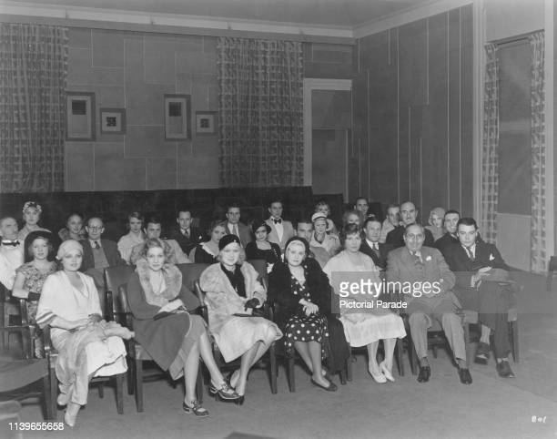 Metro-Goldwyn-Mayer stars gather in a projection room at the MGM studios for a screening, 1931. From left to right , Lilian Bond, Edwina Booth, Anita...