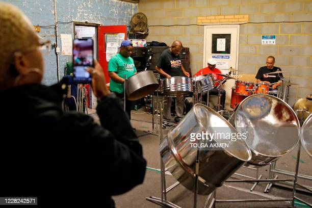 """Metronomes, one of Britain's leading steelbands """"livestream"""" a performance in west London on August 28 as Notting Hill Carnival musicians practice..."""