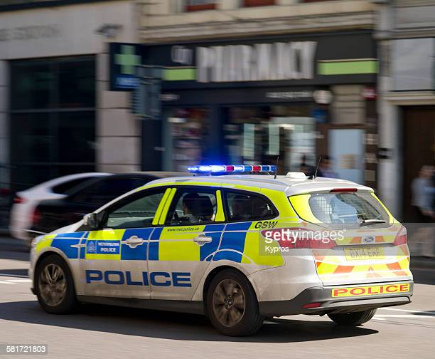 A Metroplitan Police patrol car driving through London 10th September 2015
