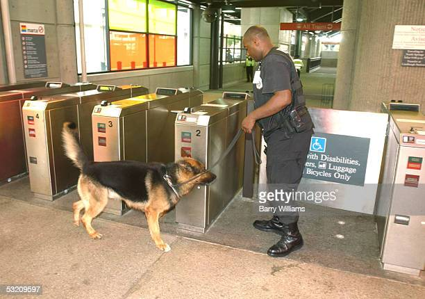Metropolatin Atlanta Rapid Transit Authority Police officer Paris Swinson searches for explosives with his bombsniffing dog Haro at the Lindbergh...