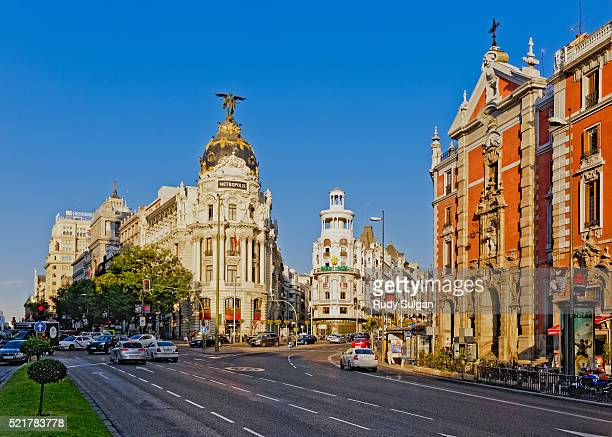 metropolis building on grand via in madrid - madrid stock pictures, royalty-free photos & images