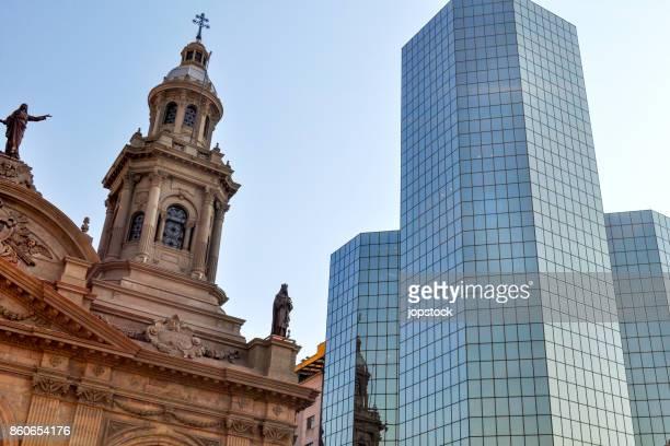 Metropolitan Cathedral and modern building at Plaza de Armas in Santiago de Chile