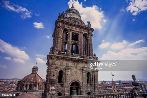 metropolitan cathedral overlooking palacio nacional - national palace mexico city stock pictures, royalty-free photos & images