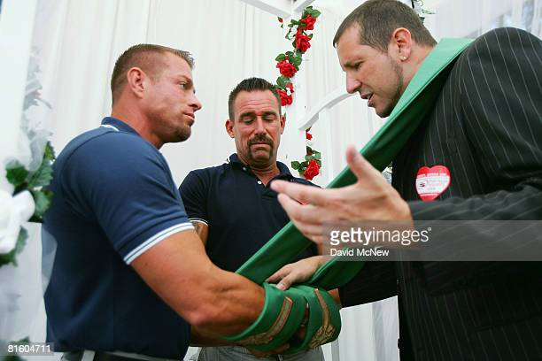 Metropolitan Community Church Los Angeles Rev Neil Thomas wraps a stole around the hands of John Martell and Rob Peters who are being joined in...