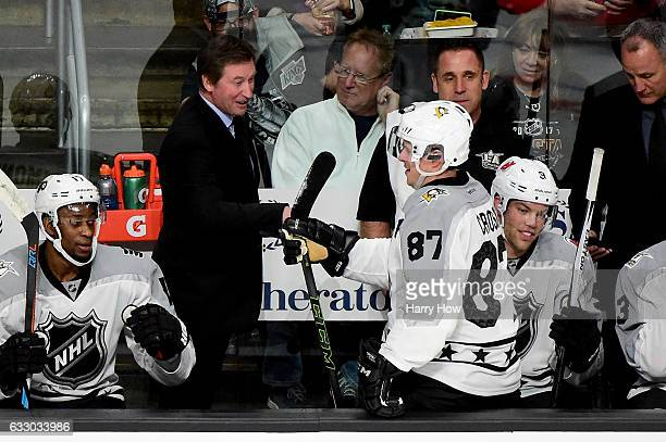 Metropolitan Division AllStars head coach Wayne Gretzky celebrates with Sidney Crosby of the Pittsburgh Penguins after a goal during the 2017 Honda...