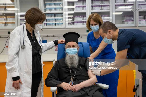 Metropolitan Hierotheos of Nafpaktos and Agios Vlasios receives a dose of the Pfizer-BioNTech Covid-19 vaccine at the Evangelismos hospital, in...