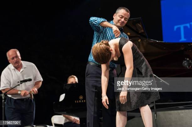 Metropolitan Opera Production Stage Manager Raymond Menard looks on as pianist/accompanist Bradley Moore winds up Metropolitan Opera soprano Erin...