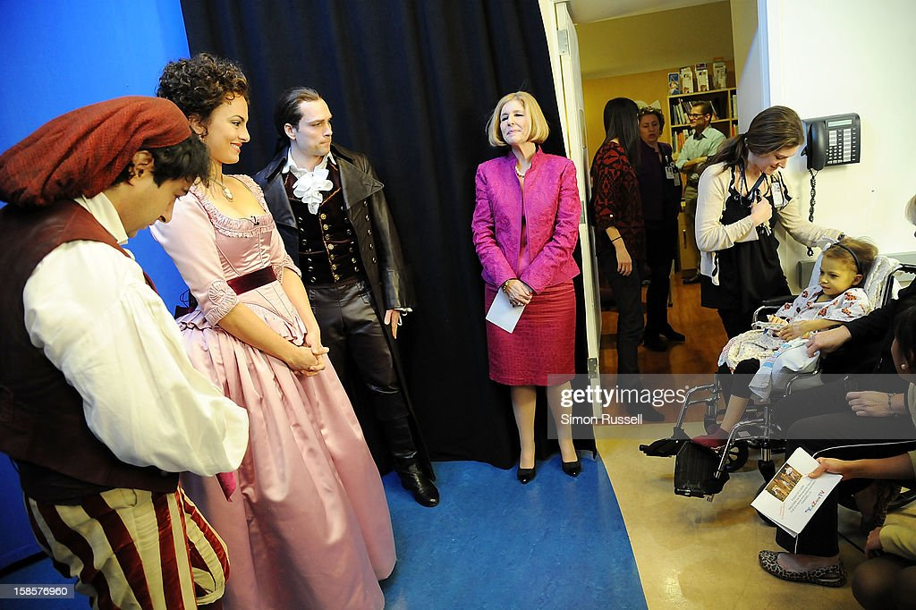 Metropolitan Opera stars Rodion Pogossov, Isabel Leonard, Alek Shrader, Carol Torchen, Clinical Dir. of Women and Children Services at Mt. Sinai Hospital and patient Catherine Lamb (in wheelchair) after performance of 'The Barber Of Seville' at the Kravis Children's Hospital at Mount Sinai Medical Center on December 19, 2012 in New York City.