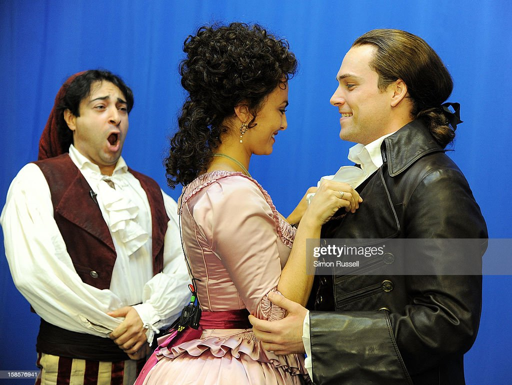 Metropolitan Opera stars Rodion Pogossov, Isabel Leonard and Alek Shrader perform 'The Barber Of Seville' at the Kravis Children's Hospital at Mount Sinai Medical Center on December 19, 2012 in New York City.