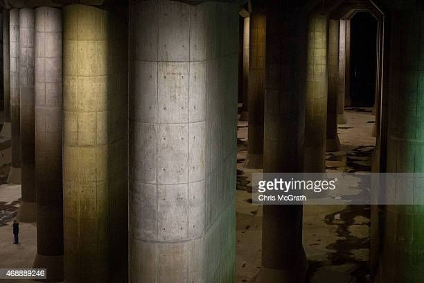 Metropolitan Outer Floodway Management Office Chief Oosu Eiichi is seen in the pressureadjusting underground water tank during a tour of the...