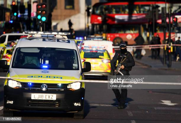 Metropolitan Police Armed Response officer stands guard near Borough Market after a number of people are believed to have been injured after a...