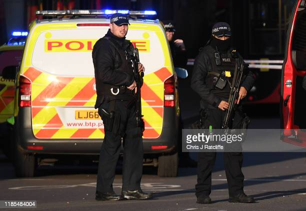 Metropolitan Police Armed Response officers gather near Borough Market after reports of shots being fired on London Bridge on November 29, 2019 in...