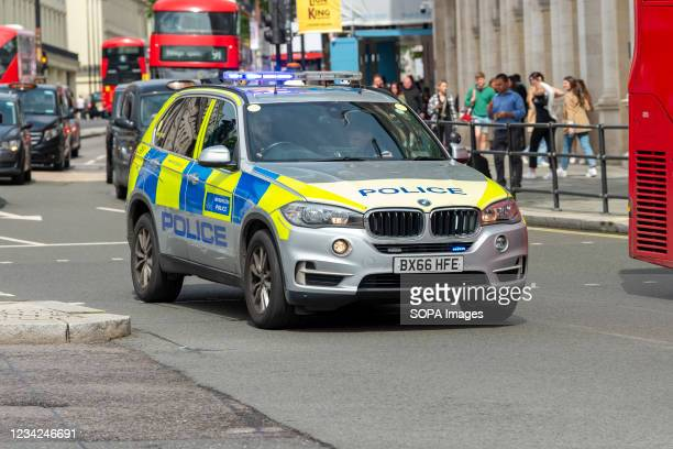 Metropolitan Police armed response vehicle drives past Trafalgar Square in London as it responds to an emergency call.