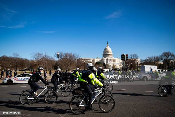 Metropolitan Police bike officers patrol following a police procession of the hearse carrying the casket of Brian Sicknick, U.S. Capitol Police...