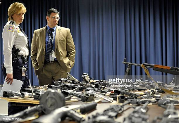 Metropolitan Police Chief Cathy L Lanier Rich Marianos Assistant Special Agent in charge of ATF observe dozens of weapons that have been confiscated...