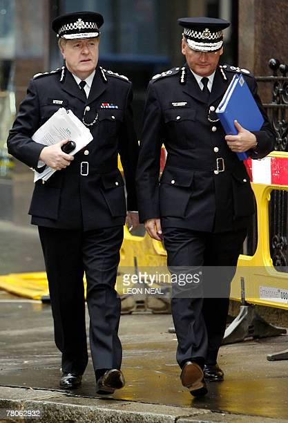 Metropolitan Police Chief Commissioner Sir Ian Blair and Deputy Commissioner Paul Stephenson arrive for the start of an extraordinary meeting of the...