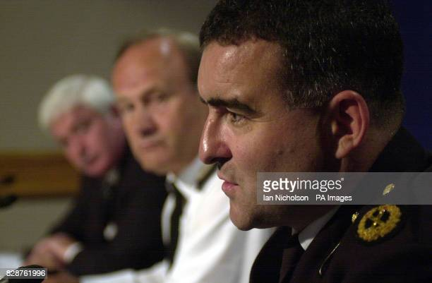 Metropolitan Police Commissioner Sir John Stevens centre and Assistant Commissioner David Veness left listen to a response from City of London Police...