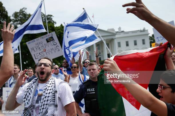Metropolitan Police Department officers separate supporters of Israel and Palestinian as they hold simultaneous demonstrations on the north side of...
