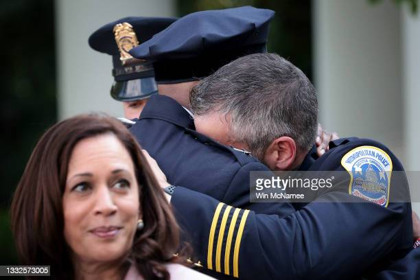 Metropolitan Police Officer Michael Fanone hugs DC Metropolitan Police Chief Robert Contee after Joe Biden delivered remarks honoring law enforcement...