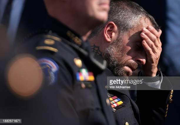 Metropolitan Police Officer Michael Fanone listens as U.S. President Joe Biden delivers remarks honoring law enforcement in the Rose Garden of the...